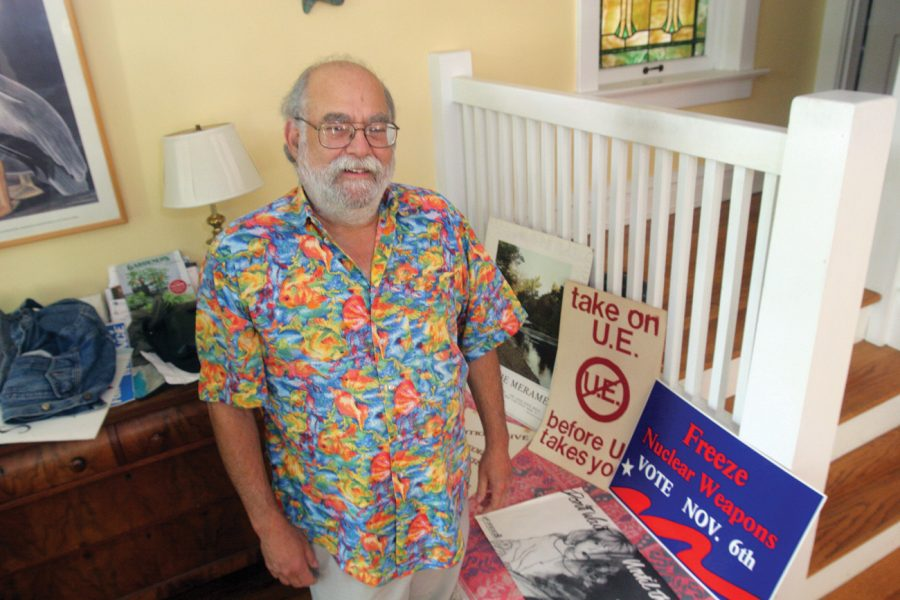 Ben Senturia with a few placards from the many campaigns on which he has worked over the years. Photo:Mike Sherwin