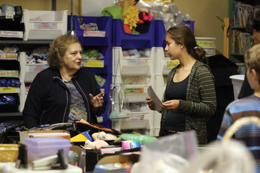 Judy Pearlstone works with volunteer Sarah Cohen at Project Backpack during BSKI's Mitzvah Day. Photo:Mike Sherwin