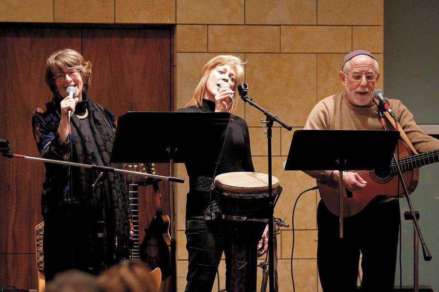 Leslie Caplan (left) performs with Marti Miller Hess and Ed Harris sing at the Hearts for Haiti fundraiser earlier this year at Central Reform Congregation. Caplan came up with the idea for the fundraiser and in three days time managed to organize the event with Jen Bersdale, Director of Advocacy and Communications at CRC, and a host of volunteers. Photo:Lisa Mandel