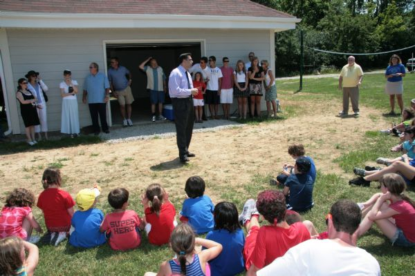 B'nai Amoona Senior Rabbi Carnie Shalom Rose speaks during the dedication of the The Jonny G Sports Shed at Camp Ramot Amoona in memory of Jonathan Goldberg, who died in 2007.