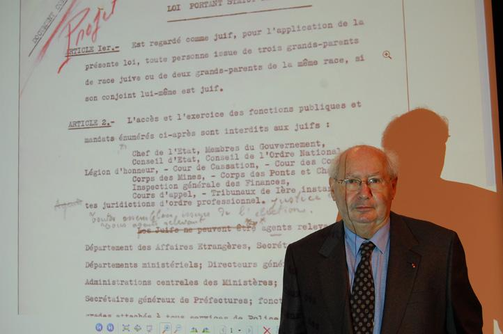 Serge Klarsfeld standing in front of a copy of the newly discovered document about the Vichy regime's attitude toward French Jews, Oct. 4, 2010.   PHOTO CREDIT: Devorah Lauter / JTA