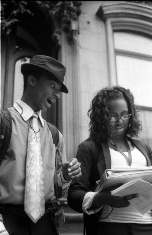 Cultural Leadership participants Jarvis Brown and Kelsey Shannon read the poetry of Langston Hughes in front of his house in New York.