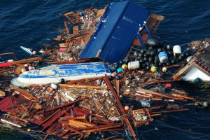 An aerial view of debris from the earthquake and subsequent tsunami that struck northern Japan, March 11, 2011. (Alexander Tidd, US Navy)