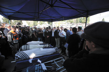 The bodies of the five victims of the terror attack in the West Bank are laid out at their Jerusalem funeral on March 13. Photo: Yossi Zamir/Flash90/JTA