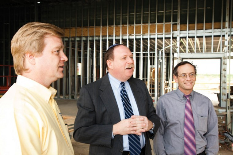 Nusach Hari B'nai Zion President Bob Kaiser (center) and Rabbi Ze'ev Smason (right) talk with Jason Parker, Project Manager for Certified Solar Solutions, LLC during a visit to the construction site of NHBZ's new building on Price Road near Old Bonhomme in Olivette. Photo: Kristi Foster