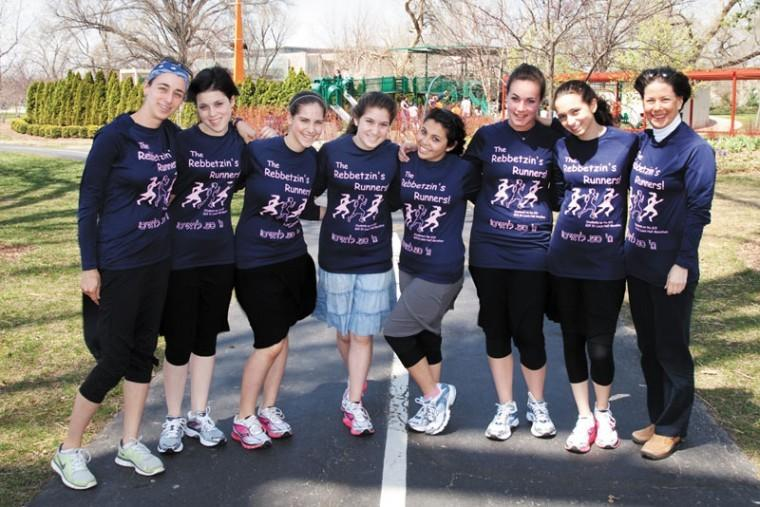 Coach Kate Friedman (left) and Go! St. Louis  President Nancy Lieberman (right) stand with the 'Rebbetzin's Runners' team of girls from Block Yeshiva and Bais Yaakov high schools during a training session on Sunday in Forest Park, in preparation for the Go! St. Louis marathon this weekend.  Photo: Kristi Foster
