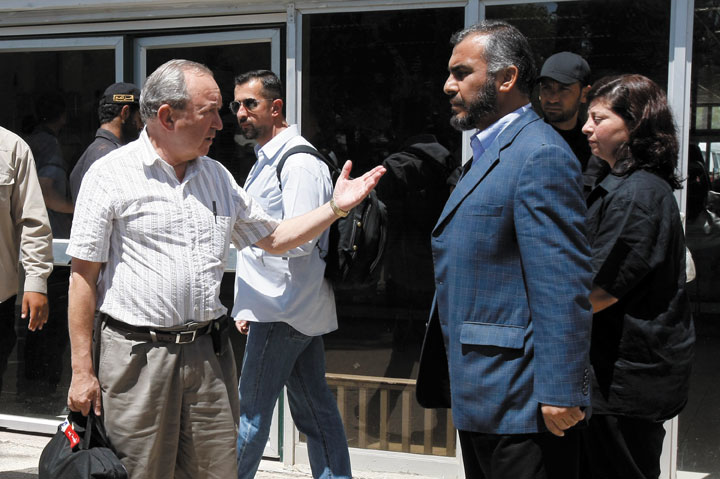 Richard Goldstone, left, shown meeting in June 2009 with Ghazi Hamad of Hamas at the Rafah border crossing with Egypt, now says his report's finding that Israel intentionally targeted civilians in the Gaza war was mistaken. Photo: Rahim Khatib / Flash90 / JTA