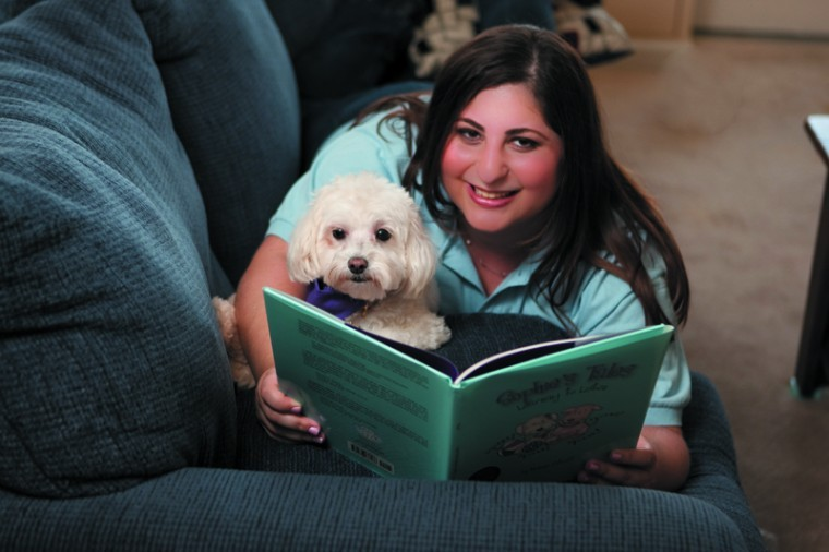Melanie Paticoff, pictured with her dog Sophie, has written an award-winning children's book about hearing loss as well as produced a video and maintained a website for children with hearing loss. Submitted photo.