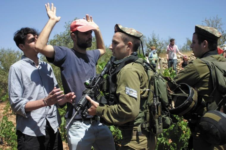 Israeli soldiers scuffle with Palestinians during a demonstration near the West Bank village of Beit Omar, Aug. 13. Some analysts have warned that a U.N. vote on Palestinian statehood could set off a new wave of Palestinian-Israeli violence. Photo: Najeh Hashlamoun/Flash 90/JTA