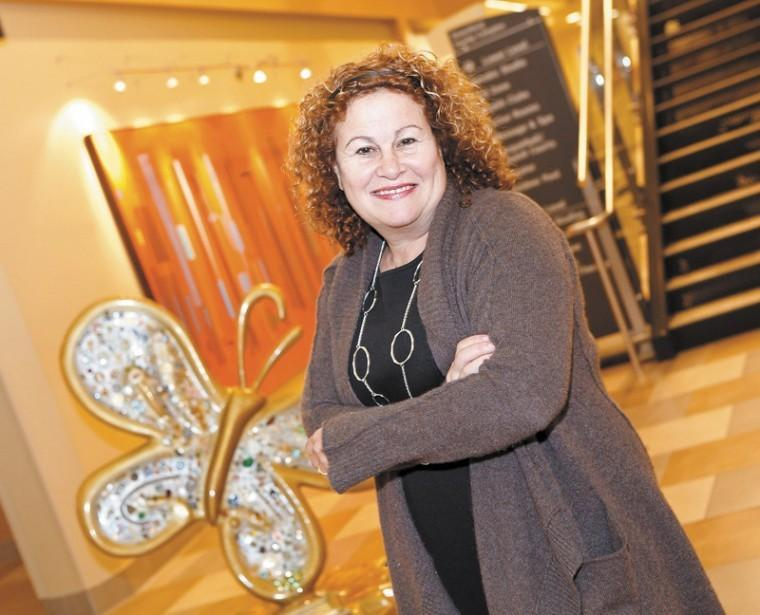 """Diane Katzman with her """"Tikkun Olam Butterfly"""" on display at the Jewish Community Center in Creve Coeur. Photo: Lisa Mandel"""