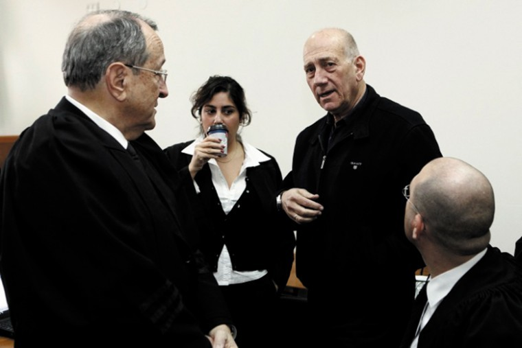 Former Israeli prime minister Ehud Olmert , pictured here in a Jerusalem court on Jan. 2, where he was on trial over alleged double-billing for travel expenses, now faces new charges regarding a real estate scandal. Photo: Uri Lenz/Flash 90/JTA