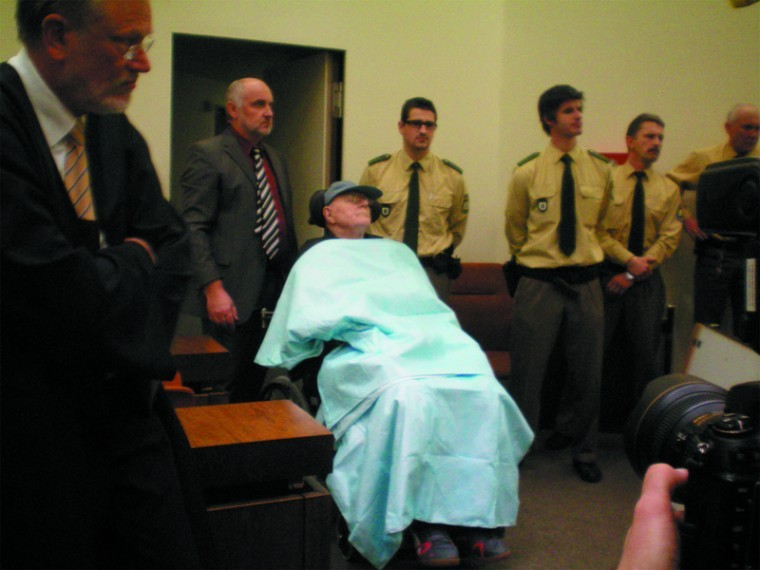 John Demjanjuk is wheeled into a Munich courtroom on Nov. 30, 2009 for the first day of his trial. The photo was taken by Sobibor death camp survivor Thomas Blatt.