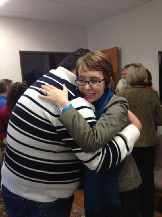 U.S. Rep. Gabrielle Giffords hugs Daniel Hernandez, the former congressional intern who helped save her life, at a private gathering Jan. 23.