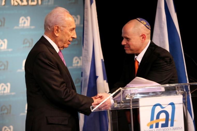 Masorti Executive Director Yizhar Hess, right, welcoming Israeli President Shimon Peres at the Masorti gala dinner, Jan. 5, 2012. Courtesy of Masorti movement