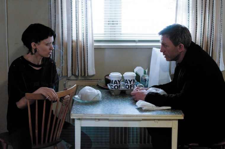Rooney Mara, left, as Lisbeth Salander, a young computer hacker, with Daniel Craig as journalist Mikael Blomkvist in David Finchers remake of The Girl With the Dragon Tattoo.