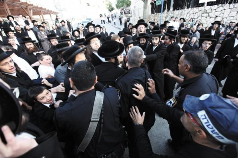 Haredi Orthodox men clash with police in the Israeli city of Beit Shemesh, Dec. 26, 2011. Photo: Kobi Gideon / Flash90 / JTA