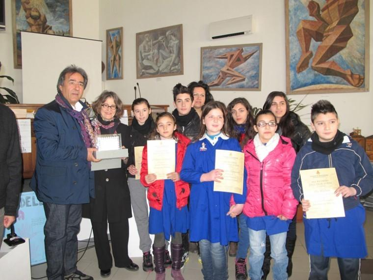 Amendolara Mayor Salvatore Antonio Ciminelli, left, standing next to JTAs Ruth Ellen Gruber, after presenting award certificates to some of the 100 schoolchildren who attended a Holocaust Memorial Day ceremony in the town hall, Jan. 27, 2012. The children received awards for art or writing projects about the Shoah.