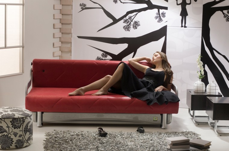Something red for Valentines? The Check-In, made in Israel by Sapapa, converts from sofa to bed in one touch.