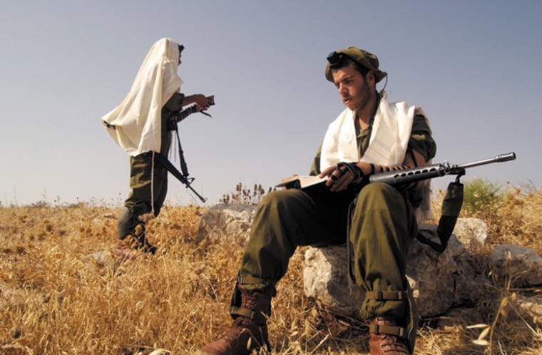 Soldiers from the Israeli armys haredi Orthodox unit called the Netzah Yehuda Battalion praying.