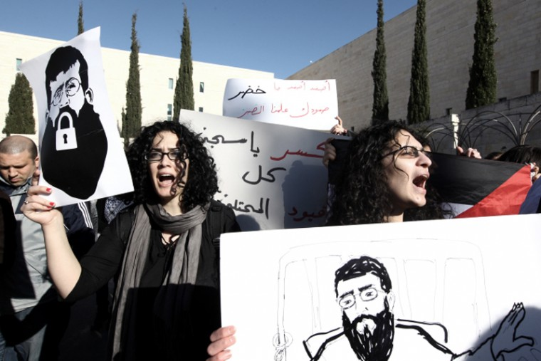 Palestinians demonstrating outside Israels Supreme Court in Jerusalem in support of Khader Adnan, who declared a hunger strike in Israeli jail more than two months ago, Feb. 21, 2012. Adnan ended his hunger strike that day following an agreement with the State Prosecutors Office.