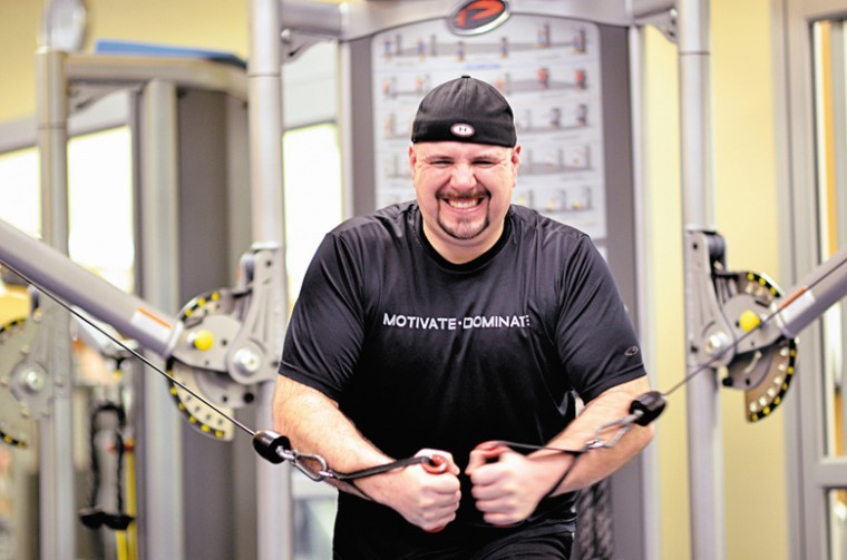Russell Glencoe works out at the JCC before a volleyball game Monday night. Glencoe is on one of the 56 teams taking part in the Jewish Light and JCC 'Lighten Up Weight Loss Challenge.