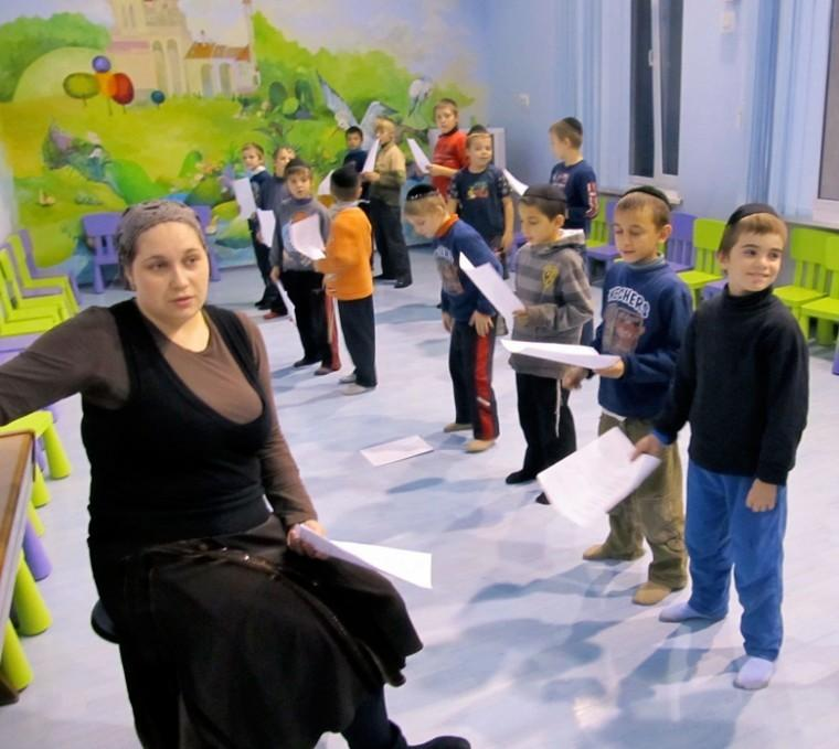 Tikva Children's Home infants' facility director Chava Melamed leads the orphanage's boys' music class.