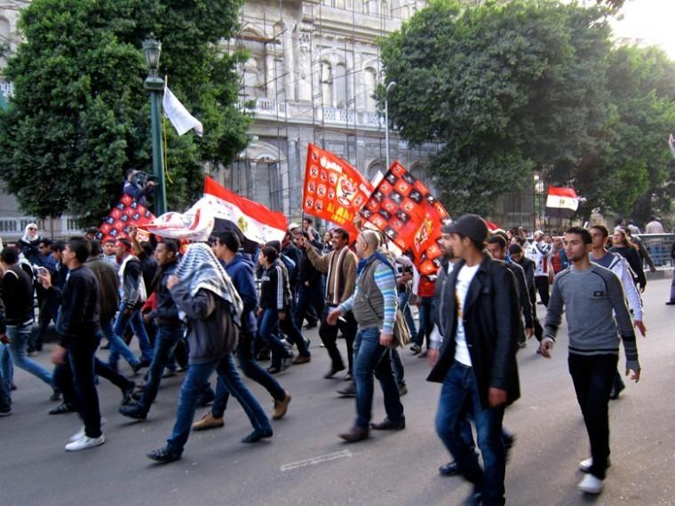 Protesters in the aftermath of deadly riots march in Cairo on Feb. 3 2012. The increasing chaos in Egypt, including the recent arrest of U.S. democracy activists, has raised questions about how it factors into U.S. and Israel security considerations in the region.