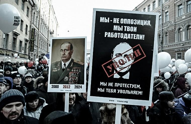 Demonstrators+in+Moscow+protest+Vladimir+Putins+re-election%2C+including+one+carrying+a+sign+reading+We+are+not+an+opposition%2C+we+are+your+employers%21+with+the+word+fired+over+a+drawing+of+Putins+face%2C+March+5%2C+2012.%0A