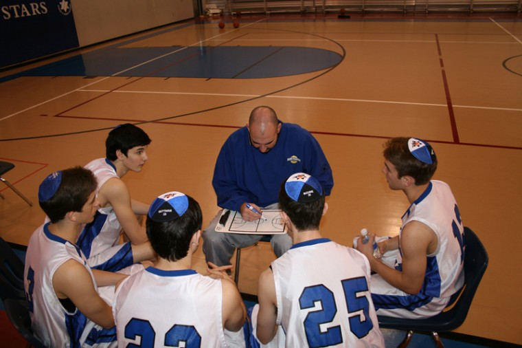 Chris Cole, coach of the boys basketball team at the Robert M. Beren Academy in Houston, offering up some strategy for his squad.