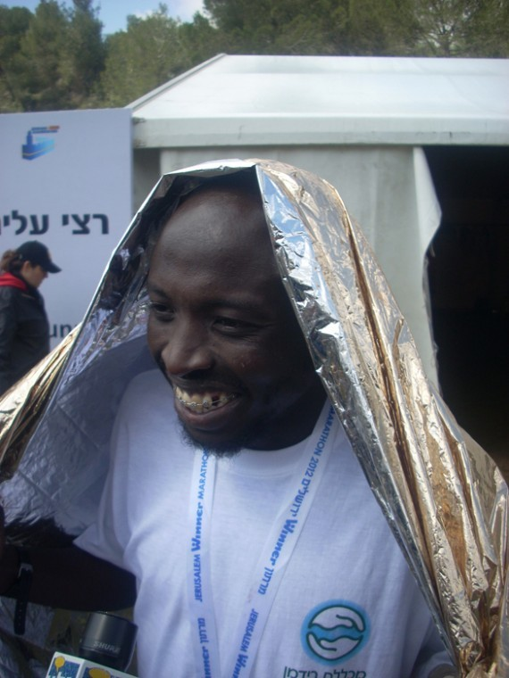"""Ashrat """"Assaf"""" Mamo, a 27-year-old immigrant from Ethiopia, became the first Israeli to finish the 2012 Jerusalem Marathon, coming in 11th place."""