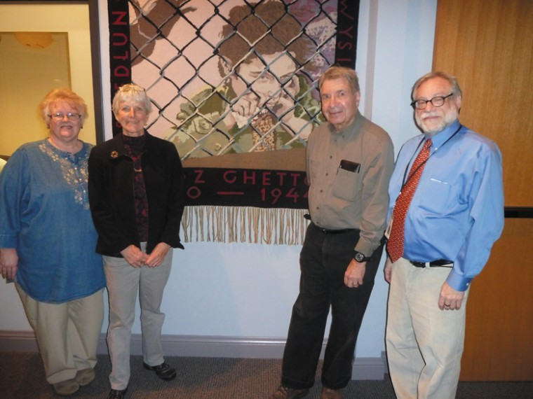 From left: Jane Olson Glidden, Weavers' Guild of St. Louis; Linda Koenig, Holocaust Museum docent who is leading the tour sponsored by the Missouri History Museum; Sheldon Helfman, husband of the late artist, and Dan Reich, Holocaust Museum Curator and Director of Education.