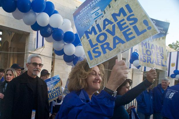 """Ana and Steven Weisman and Stephanie Trump march to Jerusalem's Jaffa Gate during the first """"mega event"""" of the Greater Miami Jewish Federation's mission of 700 people to Israel, April 23, 2012."""