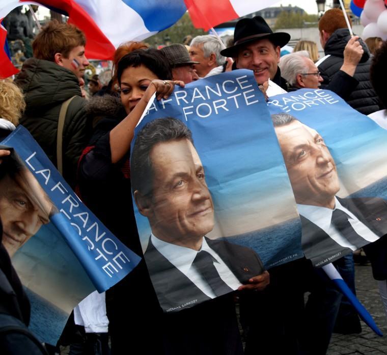 Supporters of Nicolas Sarkozy awaiting his arrival at the Place de la Concorde in Paris, April 15, 2012.