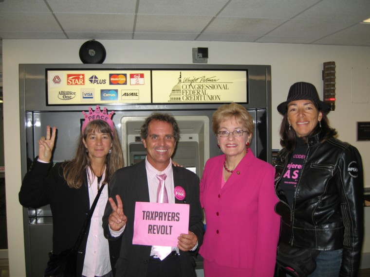 Rep. Marcy Kaptur, seen here posing with Code Pink protesters in 2008, is stressing the economy in her bid for the top Democratic spot on the House Appropriations Committee.