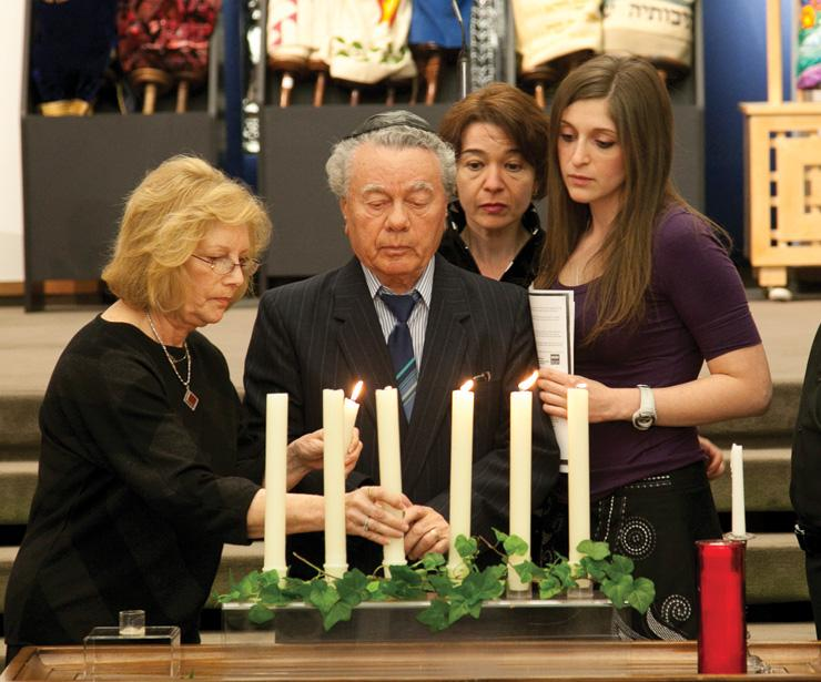 Aleksander+Reznik%2C+accompanied+by+his+family%2C+lights+a+candle+during+the+2011+Yom+HaShoah+Community+Commemoration.+File+Photo%3A+Andrew+Kerman%0A%C2%A0%0A