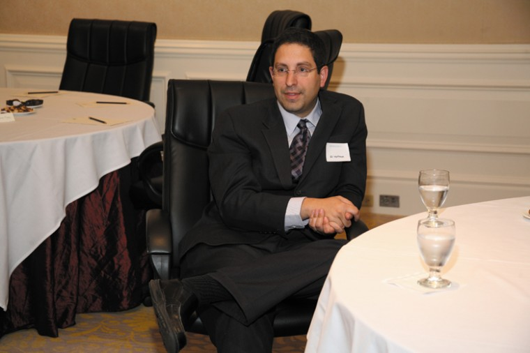 Gil Hoffman talks with guests during an informal meeting held by the Jewish Light and Anti-Defamation League.