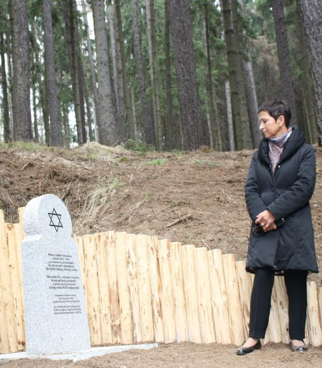 Eva Vavrecka contemplating the horrific living conditions that her mother and grandparents endured in the forest to survive World War II.