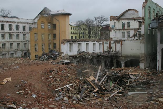 The lower part of the Schindler factory next to a demolished 19th-century building.