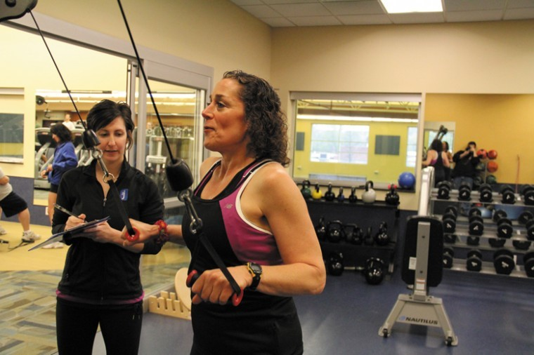 Katie Hughes of the Jewish Community Center (left) works with Leslie Koppel of Creve Coeur during the Lighten Up Weight Loss Challenge. Koppel took the top prize for Individual Female Winner.