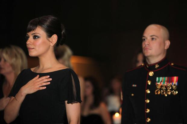 Mila Kunis, shown here with Sgt. Scott Moore during the 2011 Marine Ball, saved the life of a man who is working at her house in Los Angeles on May 7, 2012.