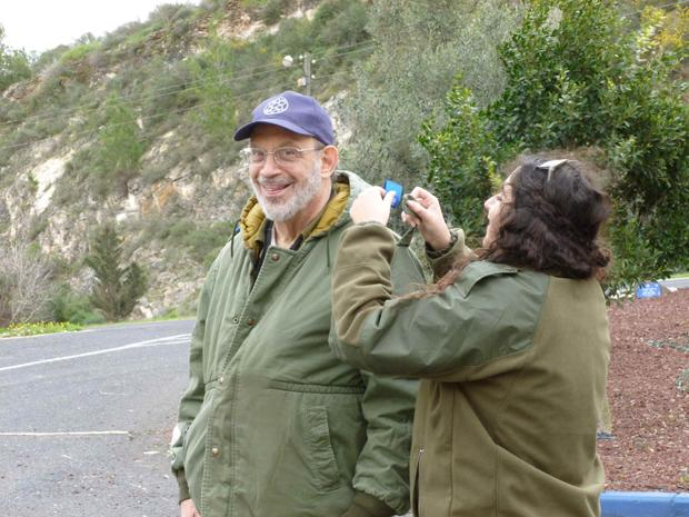 The Madricha (liaison or guide) with Volunteers for Israel pins epaulettes on the shoulder of Gerard Moskowitz.