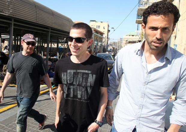 Freed Israeli soldier Gilad Shalit, center, arrives on the set of the American TV show