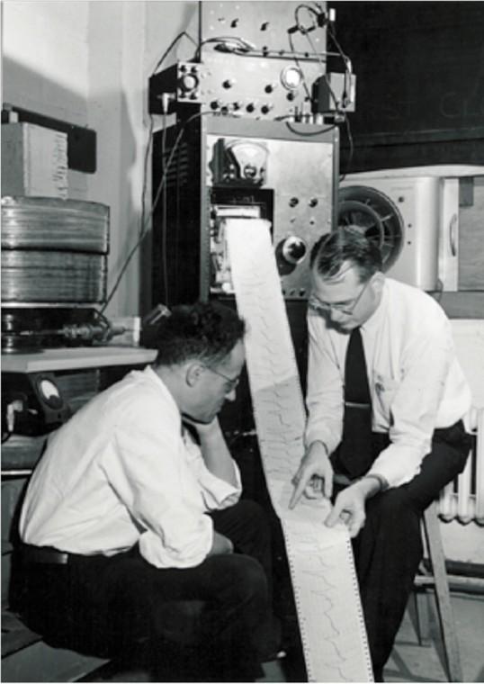 Sam Weissman, then an assistant professor of chemistry, and Jonathan Townsen examine magnetic resonance data at Washington U. around 1962.
