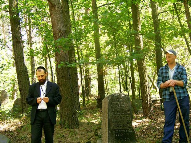 Pawel Bramson, left, at the Jewish cemetery in Warsaw.