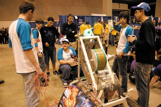 Israeli students from ORT Binyamina try to troubleshoot a problem with their robot during the FIRST Robotics competition held at the Edward Jones Dome.