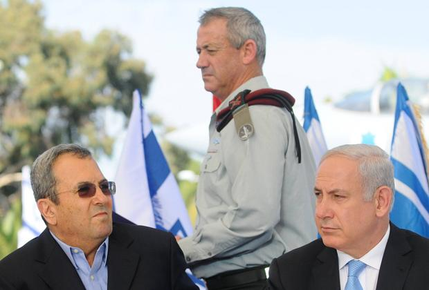 Prime+Minister+Benjamin+Netanyahu%2C+right%2C+and+Defense+Minister+Ehud+Barak+are+shown+at+an+arrival+ceremony+for+freed+Israeli+soldier+Gilad+Shalit+in+October+2011.%0A