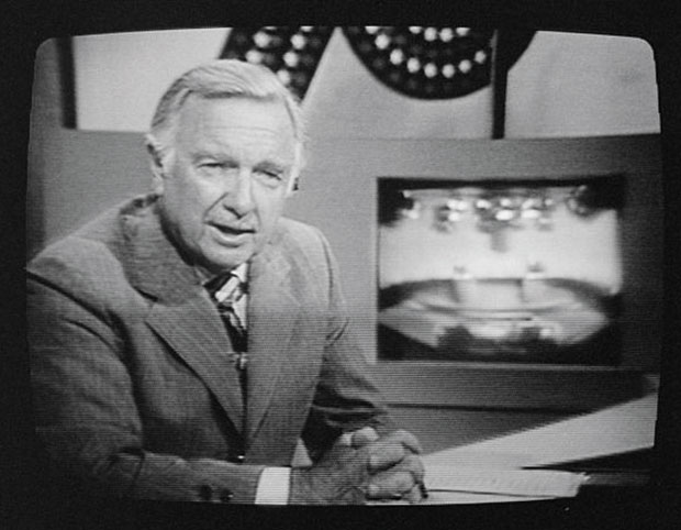 Walter+Cronkite+on+TV+during+a+presidential+debate+between+Gerald+Ford+and+Jimmy+Carter+in+1976.%0A