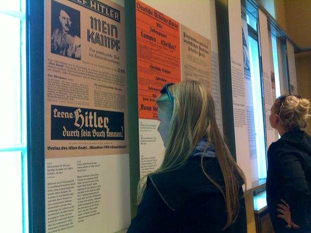 Students from the St. Ursula-Schule, a Catholic high school inGermany, view facsimiles of ads for Hitlers Mein Kampf at the Houseof the Wannsee Conference in Potsdam, site of the planning of theFinal Solution.