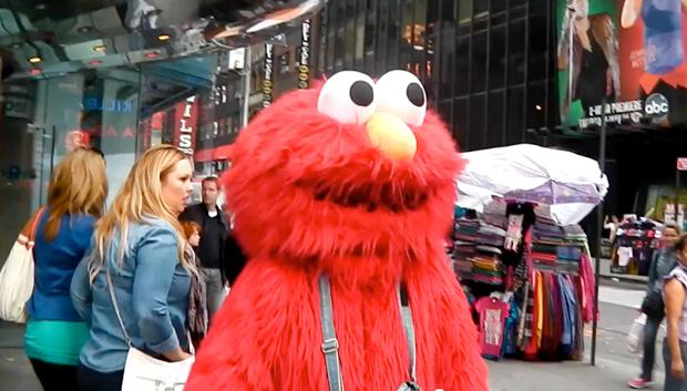 A man dressed as Elmo from