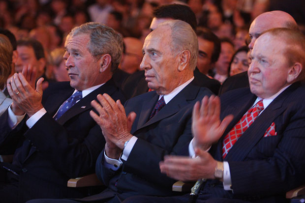 Sheldon Adelson, right, seen here with then-President George W. Bush and Israeli President Shimon Peres at a Jerusalem conference in May 2008, is at the center of controversy over contributions earmarked for Republican candidates.